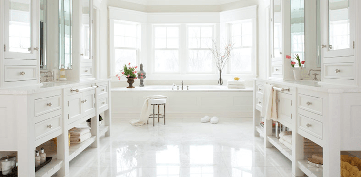 bathrooms - chic white bathroom cabinets mirrored doors stool glossy white floors  Christopher Peacock.  chic white bathroom design with white