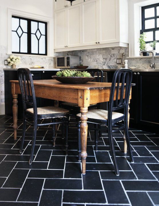 kitchens - rustic farmhouse dining table black dining chairs black tiles floor herringbone chevron pattern white upper cabinets black lower cabinets white carrara marble subway tiles backsplash stainless steel countertops.