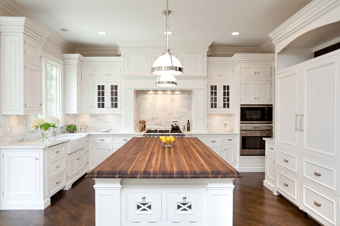 kitchens - butcher block kitchen island countertop white glass-front kitchen cabinets white carrara marble tiles backsplash farmhouse sink  Oakley