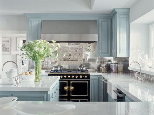 kitchens - blue kitchen cabinets La Cornue CornueFe range iridescent tiles backsplash blue kitchen island pot filler farmhouse sink double dishwashers white tone countertops