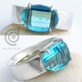 anel de prata com topazio