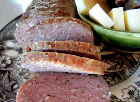 Men Love Meat / Make Your Man Summer Sausage, homemade, DIY, grass-fed, paleo, GAPS friendly, gluten-free, GF, Weston A. Price, clean meats, no hormone, no antibiotics, homemaking, photos, smoking/curing meat, Italian seasoning, maple syrup, Himalayan sea salt, Boer goat, ground goat, venison, clean out the freezer, intestinal casing, men love meat, outdoor living, no additives, healthy alternative, love your man, hunting, freezer meats, ground lamb, Italian, maple syrup, spices, McCormick's Italian Herbs Seasoning, Sea salt, sausage-making, parchment paper, foil, cheese and crackers, sandwiches