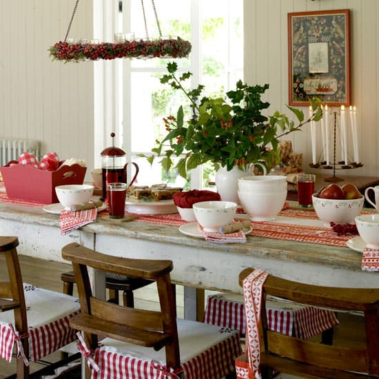 Simple and Natural Holiday Decorations, wreath tutorial, hanging chandeliers, Scandinavia style, holiday table setting, wreaths, candles, sleigh, greenery, ribbons, walnuts, antique tins, ornaments, natural elements, nature, old-fashioned Christmas, burlap table settings, festive table decor, holiday decorating, decorations, English country cottage, candles, luminaries, re-purpose, frugal, thrifty ideas, DIY, natural, home-made, centerpiece, glass trinkets, window treatments, balloon marbles, ice baubles, bird feeders, pine cones, Christmas decorations, elegant, seed pods, tree decorations, crafts, JoAnn Fabrics, linen, cotton fabrics, napkins, eclectic, fruit, canning jars, mood lighting, hand made, luminaries, holly branches, berries, pine boughs, non-electric chandelier, family table, winter display, mini potted evergreens, fireplace, God's creations, homespun, card garland, festoon handrail, snowflake tablecloth, Martha Stewart, instructions, rustic, creative, evergreens, door basket, branches, tutorial, satin bows, antique sled, garden archway, haven, Christ child, family and friends, Christmas kitchen, red and white