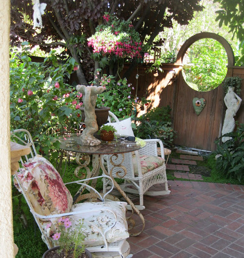 10 Garden Elements With Big Impact, decorating, garden, outdoor living, birdhouses, landscaping, nature, natural, build it, decor, yard, landscape, planning, DIY, rustic, tuteur, elements, stonework, trellises, arbors, pathways, vines, climbing roses, Zephirine Drouhin, metal supports, blue pottery, easy care grasses, enclosed porches, patios, shady conversation nooks, rockers, recycled furniture, swings, fire pit, emergency cooking, potting shed, stick teepees, Bison hand well pumps, rock walls, clumps of perennial bulbs, old garden gates, latch, antique hardware, inspiration, the shaded front porch, patio, wicker rockers, outdoor nook