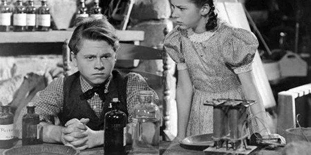 Rediscovering Great Classic Family Films, family movie night, boy holding remote control, watching movie, parents and children watching TV, little boy with remote control, happy family, smiling children, Young Tom Edison, black and white film, old movie, Mickey Rooney, character-building movie, Family movie night, classic film, 1940, rated PG