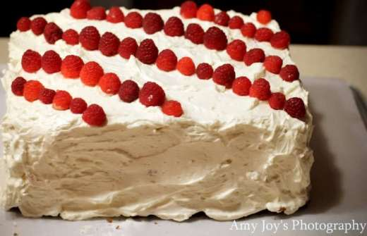 Honey-Sweetened Frosting (Have Your Cake & Eat It Too), frosting a cake, making a layer cake, white chocolate, spreading icing, healthy alternative, rich, creamy, white sugar-free frosting, healthier version, Gluten free option, red raspberry, layer cake, baking, white cake with red raspberries, diagonal