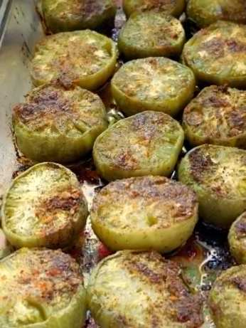 Favorite Southern Country Cooking: Oven-Roasted Green Tomatoes, grilled, fried, tomato plants, chop out tomato vines, seasonal food, side dish, starter, appetizer, Jackson, Mississippi, Southern cooking, ripen in windowsill, cut in half, olive oil, sea salt, cornmeal, shredded cheese, glass casserole dish, recipe, directions, ingredients, burger topping, crusty bread, top pizza, fried green tomatoes video,
