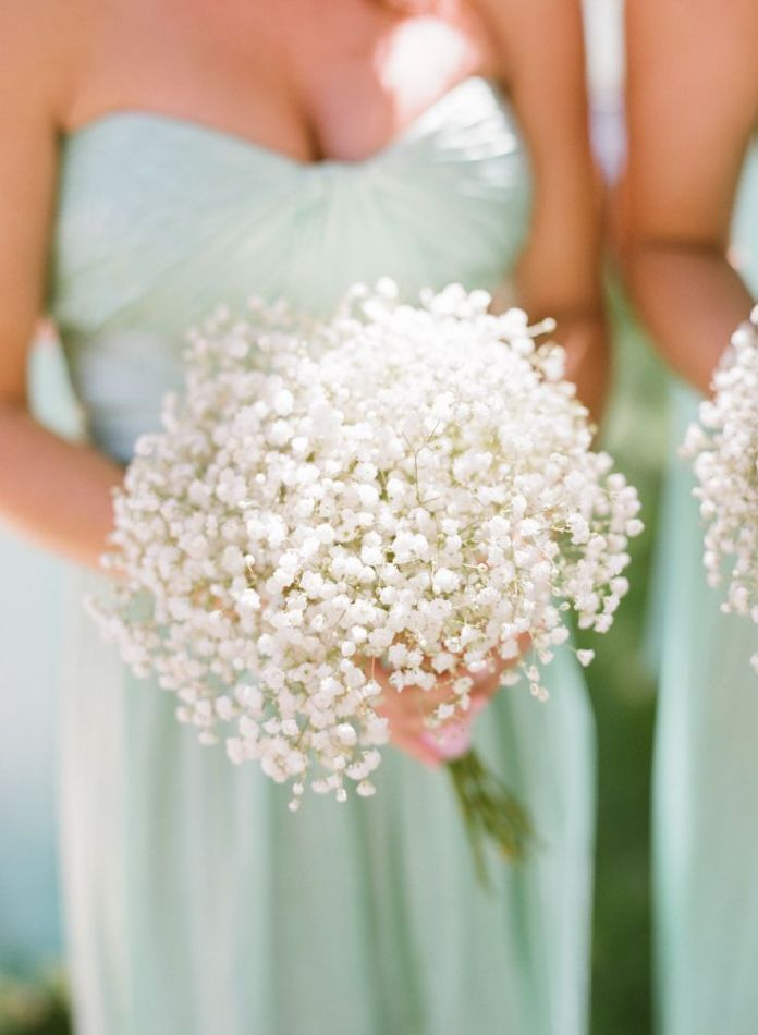 Mint bridesmaid dresses and baby's breath bouquets