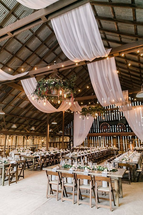 rustic country greenery barn wedding reception decor with draping fabric