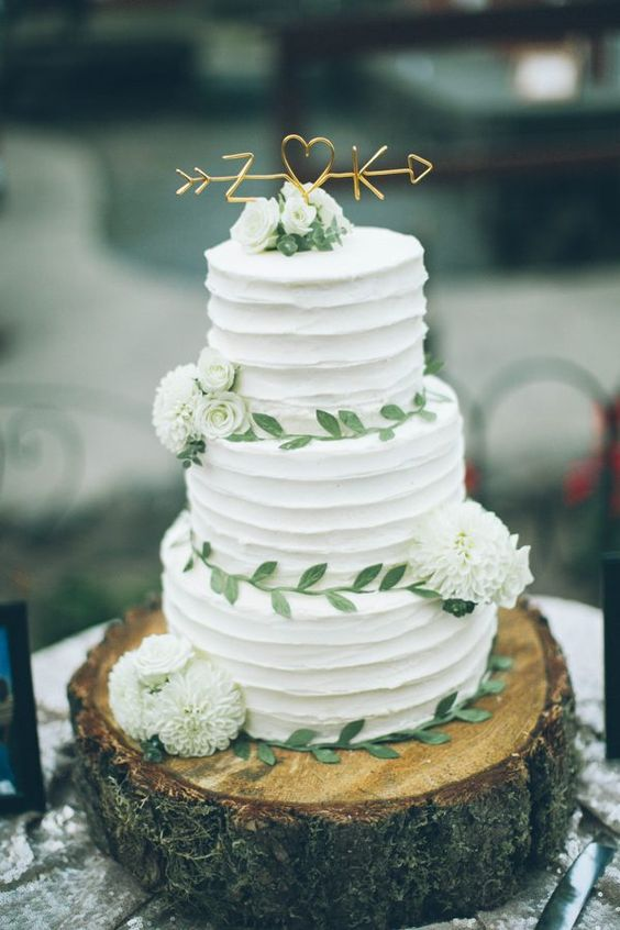 sweetest tree-trunk wedding cake with adorable golden topper via From The Daisies