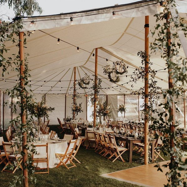 Greenery tented wedding reception decor 1