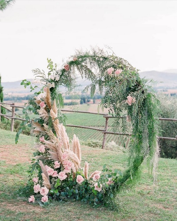 greenery and blush floral wedding arbor
