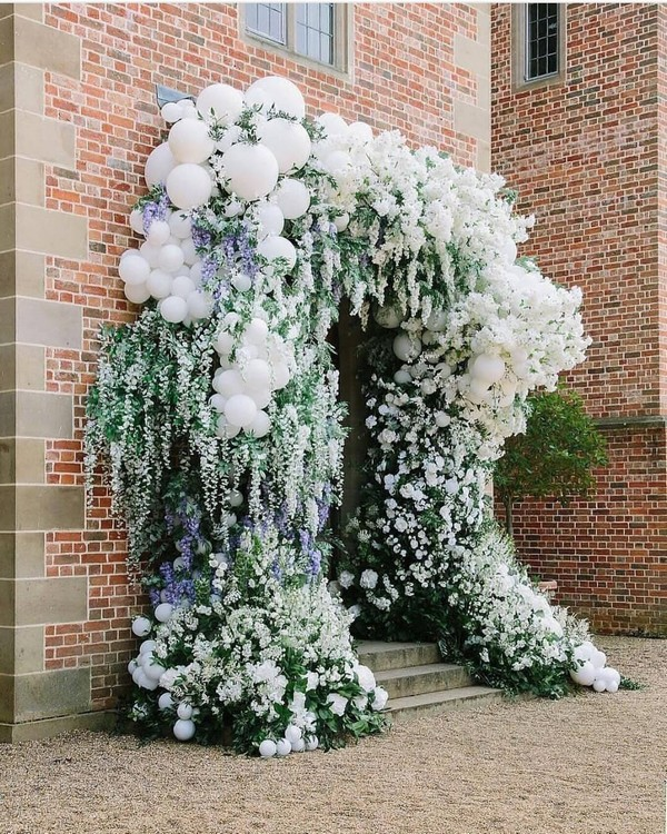 greenery and white balloons wedding entrance 7