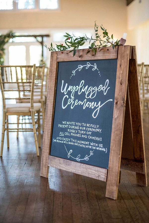 Handmade chalkboard sign for an unplugged wedding ceremony