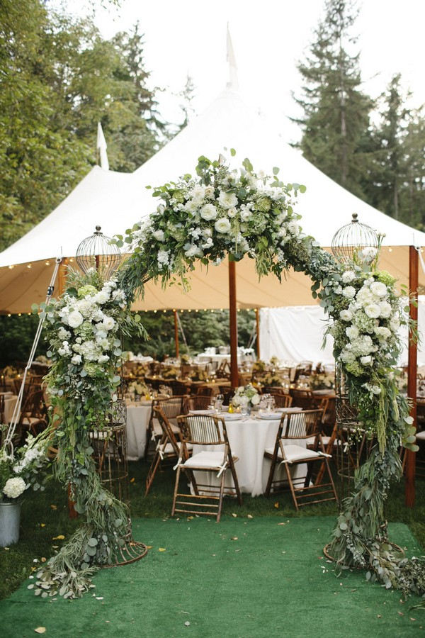 greenery outdoor tented wedding entrance