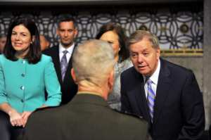 U.S. Sen. Lindsey Graham, R-S.C., greets Marine Corps Commandant Gen. James Amos before a Senate Armed Services Committee hearing on sequestration at the Dirksen Senate Office Building in Washington, D.C., Feb. 12, 2013. U.S. Army photo by Sgt. 1st Class Jim Greenhill