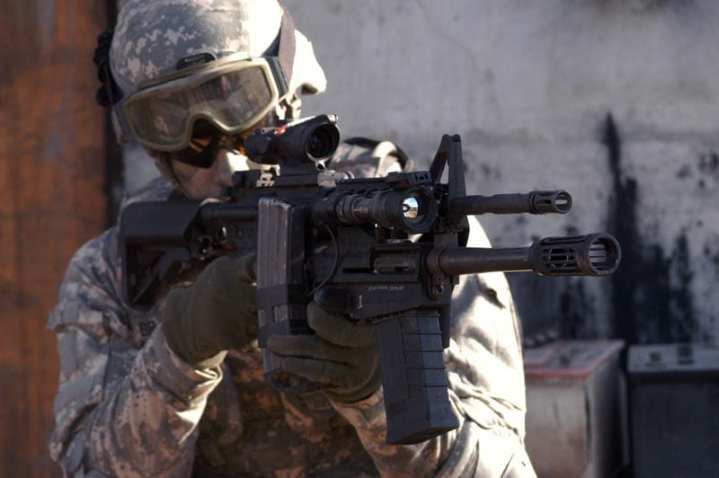 The U.S. Army expects to field 35,000 M26 12-gauge Modular Accessory Shotgun Systems (MASS) in the fall to infantry, MPs, and Special Forces troops in theater. The MASS was designed to attach to an M16 or M4, but also comes with a collapsible stock to be used as a stand-alone weapon. U.S. Army photo courtesy of PEO Soldier