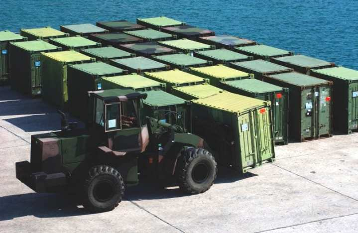 A tractor moves a quadcon container at Kin Red Port, Okinawa, Oct. 10, 2009. Quadcons are modular, lightweight, and durable containers used for storage and transportation of equipment and supplies during deployment and in garrison. The gear belongs to 12th Marine Regiment, which departed for Combined Arms Training Center Camp Fuji, Japan, Oct. 11, on the high-speed vesssel Westpac Express to conduct an exercise called Fuji Combined Arms Operation.