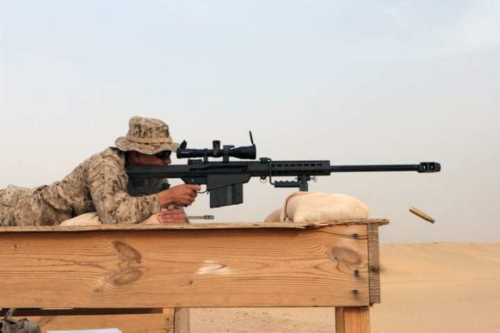U.S. Marine Corps Sgt. John F. Winnick, sniper team leader of Scout Sniper Platoon, Headquarters and Service Company, 3rd Battalion, 1st Marine Regiment, 13th Marine Expeditionary Unit, fires his M107 .50-caliber Special Applications Scoped Rifle at Udari Range, Kuwait, May 30, 2007. A market survey to identify potential sources for M107 fabrication – as well as amended specifications concerning maximum barrel pressure for a potential new carbine – are just two indications of the U.S. military's desire to extend the reach of small arms. U.S. Marine Corps photo by Lance Cpl. Kyle J. Keathley.