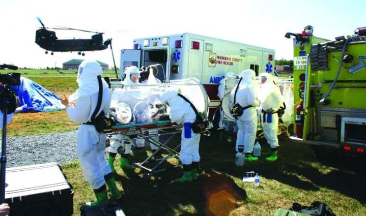 Members of the Army Medical Research Institute of Infectious Diseases Aeromedical Isolation Team prepare to move a patient from one isolator to another during an exercise. While combat casualties have demanded the greatest share of resources, MRMC has not forgotten the importance of defending against what is historically a major threat to armies in the field – infectious disease. U.S. Army photo by Sarah Maxwell Fort Detrick Standard.