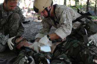 A Navy corpsman practices emergency field medical procedures during Tactical Combat Casualty Care training at the U.S. Army John F. Kennedy Special Warfare Center and School's Joint Special Operations Medical Training Center at Fort Bragg, N.C. Photo by Benjamin Abel, courtesy of JFKSWCS.