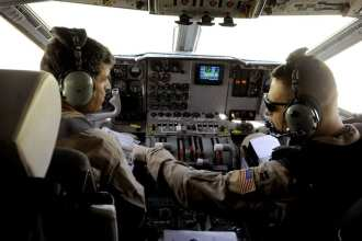 Capt. Larry Needham (right) goes over preflight checklist items with Capt. Mohammad-Shah Ahmadzai prior to take-off for an operational mission May 15, 2010, at Kabul International Airport, Afghanistan. Since November 2009, Combined Air Power Transition Force Airmen have been training Afghan C-27 Spartan pilots and loadmasters to conduct strategic and tactical airlift, airdrops and presidential support. Needham is a C-27 pilot assigned to the 538th Air Expeditionary Advisory Squadron. Ahmadzai is an Afghan National Army Air Corps C-27 pilot. U.S. Air Force photo by Staff Sgt. Manuel J. Martinez.