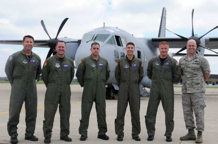 The first operational U. S. C-27J Spartan crew is flanked by the crew's bosses:  Lt. Col. Rob Schuett, 164th Airlift Squadron commander (far left) and 179th Airlift Wing commander Col. Gary A. McCue (far right) are both pilots but are not yet checked out in the new airlifter. Between them, the first operational crew consists of (left to right) loadmaster Master Sgt. Mike Keller; loadmaster Senior Master Sgt. Chris Morehead; pilot Maj. Chris Sopko and pilot Maj. Jeff Cepretto. ANG photo by Senior Airman Joseph Harwood.