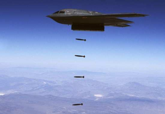 A B-2 Spirit drops 32 inert Joint Direct Attack Munitions at the Utah Testing and Training Range. A B-2 can carry scores of JDAMs and drop them on many targets during a single mission using GPS guidance. U.S. Air Force photo.