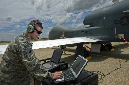 Staff Sgt. Ryan Conversi, a dedicated crew chief for the RQ-4 Global Hawk, prepares the unmanned aircraft system for launch using the Vehicle Test Controller (VTC) while reviewing technical orders. Staff Sgt. Conversi is a member of the 12th Reconnaissance Squadron, Beale Air Force Base, Calif.  U.S. Air Force photo by Staff Sgt. Bennie J. Davis III
