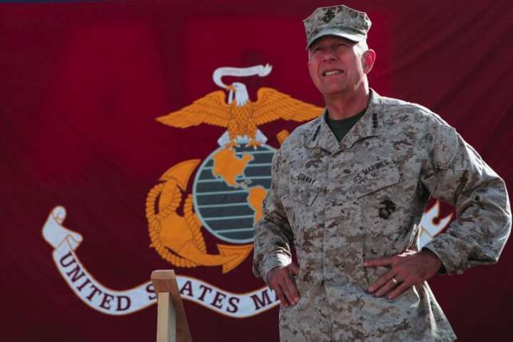 Then-Commandant of the Marine Corps, Gen. James T. Conway, waits to address Marines at Camp Leatherneck, Aug. 18, 2010. Conway , accompanied by Sergeant Major of the Marine Corps Sgt. Maj. Carlton Kent, toured Marine units in southern Afghanistan.   The two leaders answered questions during the town hall meetings and updated Marines on the current condition of the Marine Corps. USMC photo by Sgt. Heidi Agostini.