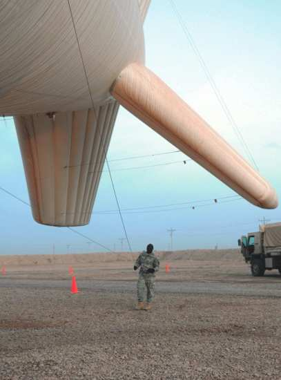Sgt. David L. Holton, assigned to B troop, Regimental Troop Squadron, 278th Armored Cavalry Regiment, Tennessee Army National Guard, with the 13th Sustainment Command (Expeditionary), headquartered out of Knoxville, Tenn., prepares the RAID Blimp for launching into the atmosphere at Camp Taji, Iraq, March 25, 2010.   U.S. Army photo By Sgt. Shannon R. Gregory.