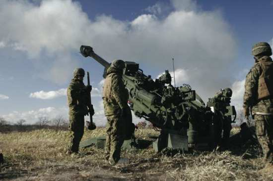 U.S. Marines with Kilo Battery, 3rd Battalion, 12th Marine Regiment (3/12) fire the M777 howitzer during an annual artillery relocation training fire mission at Yausubetsu training site in Hokkaido, Japan, Nov. 20, 2008. U.S. Marine Corps photo by Lance Cpl. Claudia M. Palacios.