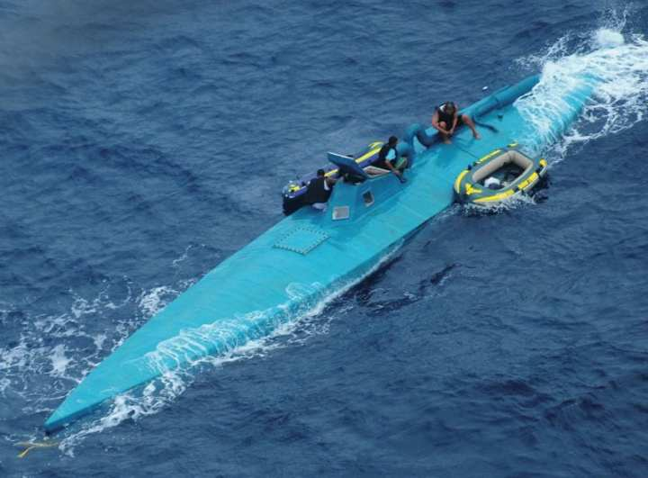The crew of a semi-submersible drug trafficking vessel prepares to abandon their boat before being intercepted and detained by the Coast Guard approximately 150 miles northwest of the Colombian-Ecuador border Jan. 8, 2009. A dozen suspected drug smugglers were apprehended in the Eastern Pacific Ocean following the interception of three semi-submersible vessels within nine days.  U.S. Coast Guard photo.
