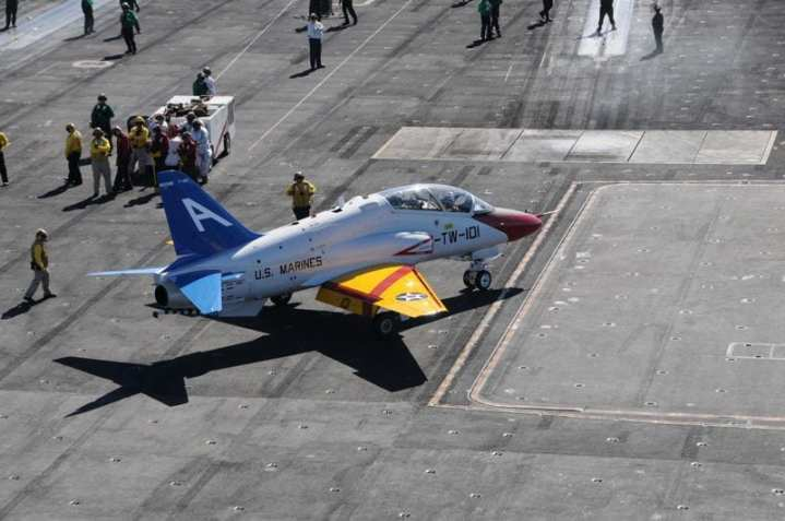 A T-45C Goshawk training aircraft taxis the flight deck before launch from the aircraft carrier USS Nimitz (CVN 68). The Goshawk has been painted in honor of the Centennial of Naval Aviation in 2011. Nimitz was conducting training wing carrier qualifications off the coast of Southern California. U.S. Navy photo by Mass Communication Specialist 3rd Class Casey Amdahl.
