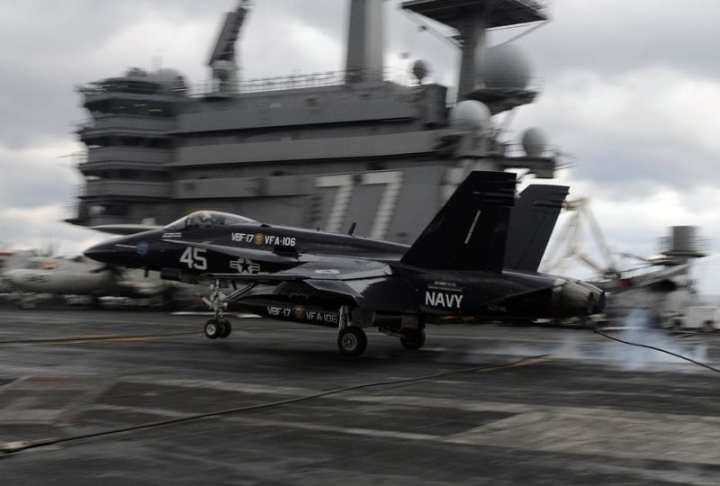 """Capt. Dan """"Dozer"""" Dwyer, commanding officer of Strike Fighter Squadron (VFA) 106, lands an F/A-18C Hornet aboard the aircraft carrier USS George H.W. Bush (CVN 77). The aircraft is painted in commemoration of the Centennial of Naval Aviation. George H.W. Bush is conducting training operations in the Atlantic Ocean. U.S. Navy photo by Mass Communication Specialist 3rd Class Nicholas Hall."""