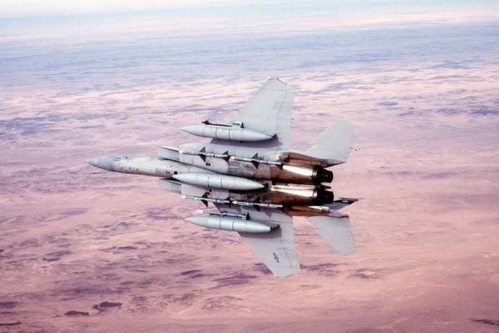 A 58th Tactical Fighter Squadron F-15 Eagle aircraft banks to the right following refueling during Operation Desert Storm.  The aircraft is armed with four AIM-7 Sparrow missiles on the fuselage, an AIM-9 Sidewinder missile on the left wing and an AIM-120 advanced medium range air-to-air missile on the right wing. DoD photo.