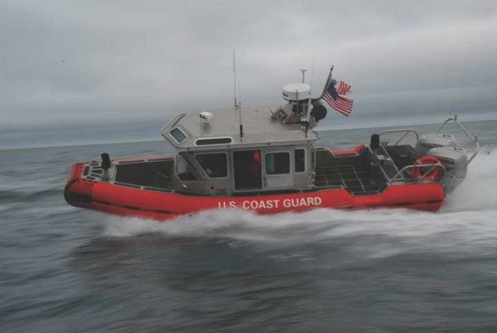 A 25-foot Defender-class response boat crew operates in the Arctic waters off Barrow, Alaska. The 25-foot boat is the primary safety and security response boat for the Coast Guard, which is crewed here by three members of Coast Guard Station Valdez. U.S. Coast Guard photo by Petty Officer 1st Class David Mosley