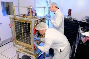 FalconSAT-5 undergoing checks in clean room.