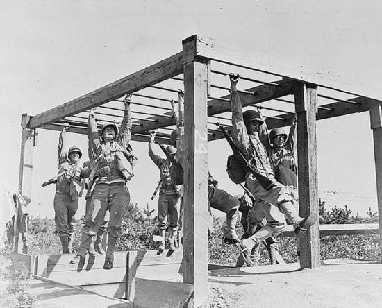 Soldiers train on an obstacle course during World War II