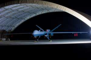 An armed MQ-9 Reaper in a hangar on Joint Base Balad.