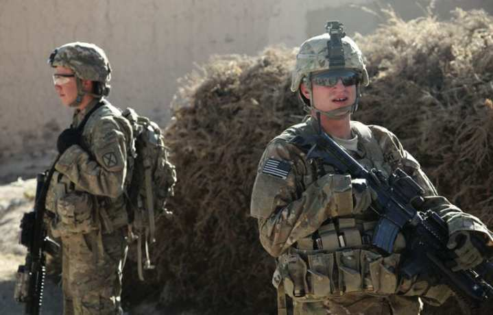 U.S. Army Spc. Devin Bryant and Pfc. Corey Shafer, 1st Platoon, Apache Company, 2nd Battalion, 4th Infantry Brigade Combat Team, 10th Mountain Division, provide security in the village of Dahanah, Wardak province, Afghanistan, during a meeting with the village elders Dec. 2, 2010. In February, the Army announced it would begin providing combat uniforms in the new MultiCam camouflage pattern shown here, which was found to be more effective in Afghanistan than the ACU pattern used previously. U.S. Army photo by Sgt. Sean P. Casey