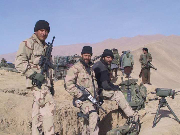 American Special Forces and members of the Northern Alliance west of Konduz, Afghanistan, in late 2001. U.S. Army photo