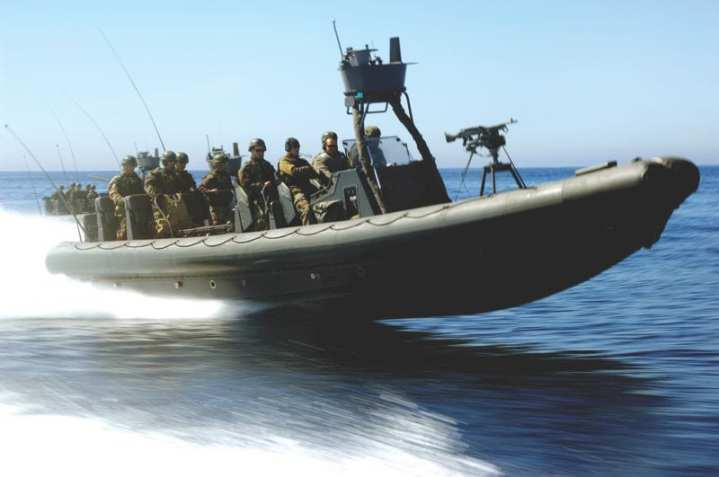 Special Warfare Combatant-craft Crewmen (SWCC) candidates from Crewman Qualification Training (CQT) Class 61 ride a rigid-hull inflatable boat to the Southern California offshore naval gunnery range for a training exercise on March 18, 2009. CQT is a 14-week course that teaches Special Warfare Combatant-craft Crewmen candidates the skills they need as members of the Naval Special Warfare boat teams. Candidates learn navigation, craft maintenance and repair, towing, anchoring, and weapons. U.S. Navy photo by Mass Communication Specialist 2nd Class Arcenio Gonzalez Jr.