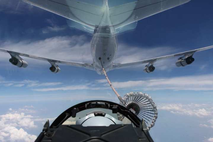 An Omega Air tanker refuels RAAF Super Hornets during and exercise