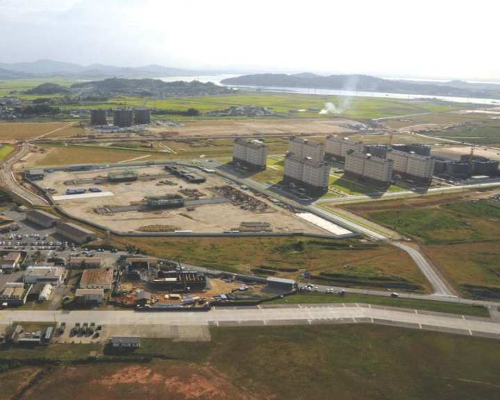 Many key facilities can be seen here, including build-to-lease senior leaders' quarters under construction and three family housing towers and six barracks that were recently completed. Utilities infrastructure projects are currently under way. This site will also hold an elementary and high school, on which construction recently began. Photo by Patrick Bray