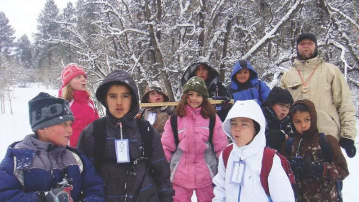 """Hildreth """"Coop"""" Cooper of the Albuquerque District's Durango, Colo., Regulatory Office conducts nature studies' tours for students to teach about the role of snow science in watershed management. Cooper leads school groups through an outdoor classroom trail circuit in the San Juan National Forest. All photos courtesy of the U.S. Army Corps of Engineers"""