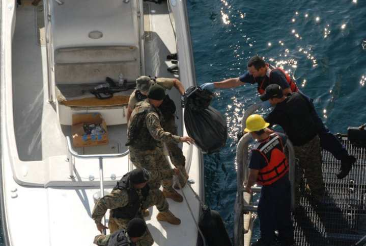While in the eastern Pacific Ocean, the crew of the CGC Bertholf, a 418-foot national security cutter homeported in Alameda, Calif., transfers recovered cocaine to Panamanian Maritime Forces, Nov. 24, 2011, from the cutter'€™s rescue platform. The drug was jettisoned from a go-fast boat when the Bertholf'€™s crew disrupted illicit narcotics-smuggling activities. U.S. Coast Guard photo
