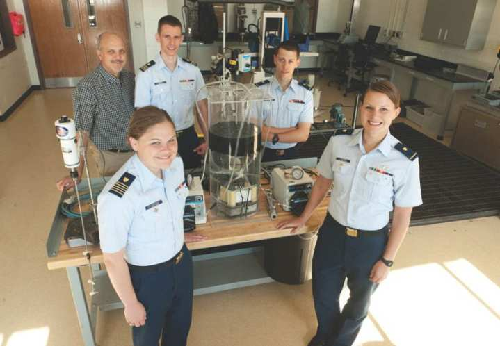 (Clockwise from top left) Stephen Grenier and U.S. Coast Guard Academy 1st Class Cadets Devon Quinn, Trevor Auth, Holly Madden, and Katie Schumacher pose for a photograph April 27, 2012, at the U.S. Coast Guard Academy in New London, Conn. The first class cadets designed and built a graywater treatment plant, which is designed to filter used, non-sewage water on Coast Guard cutters. U.S. Coast Guard photograph by Petty Officer 3rd Class Diana Honings