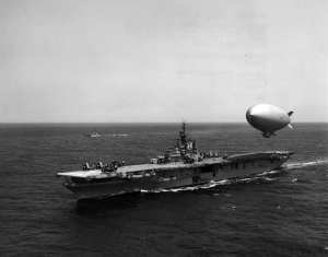 A U.S. Navy airship hovers over the carrier Leyte (CVS 32) for refueling, May 5, 1955. National Museum of Naval Aviation photo