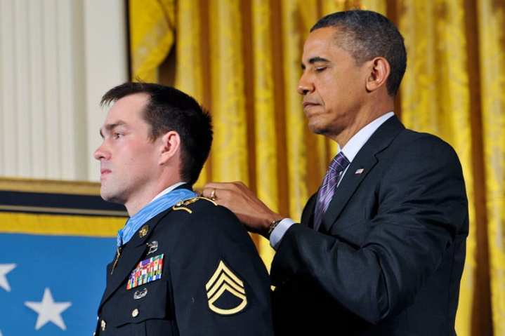 President Barack Obama presents the Medal of Honor to former Army Staff Sgt. Clinton L. Romesha during a ceremony in the East Room at the White House in Washington, D.C., Feb. 11, 2013. Romesha received the Medal of Honor for his actions during a daylong firefight in Afghanistan in October 2009. U.S. Army photo by Leroy Council